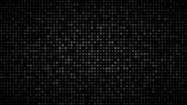 Sfondo scuro astratto di piccoli cerchi di varie dimensioni nei toni dei colori nero e grigio.