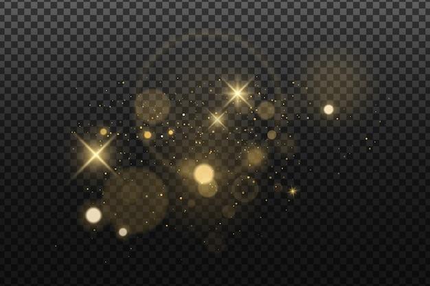 Bokeh dorato astratto delle luci isolato sull'oscurità