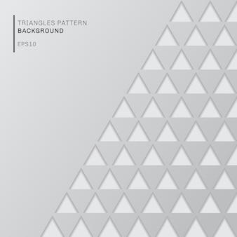 Triangoli grigi astratti modellano il fondo bianco