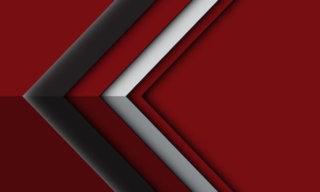 Direzione dell'ombra leggera della freccia d'argento grigia astratta geometrica sul fondo futuristico rosso di tecnologia