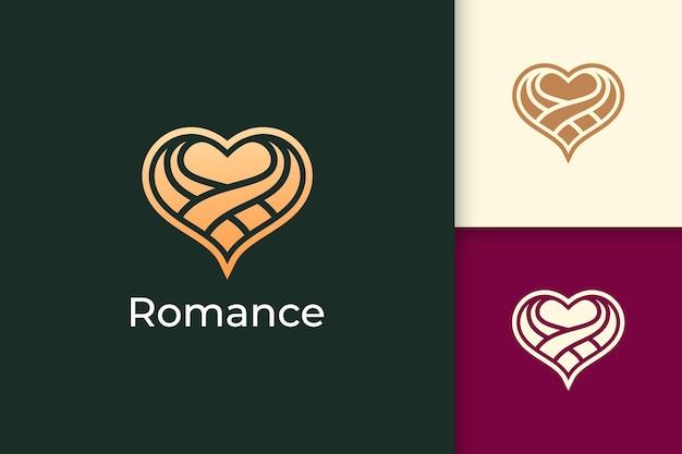 Il logo astratto di amore di lusso rappresenta il romanticismo o la relazione con il colore dell'oro