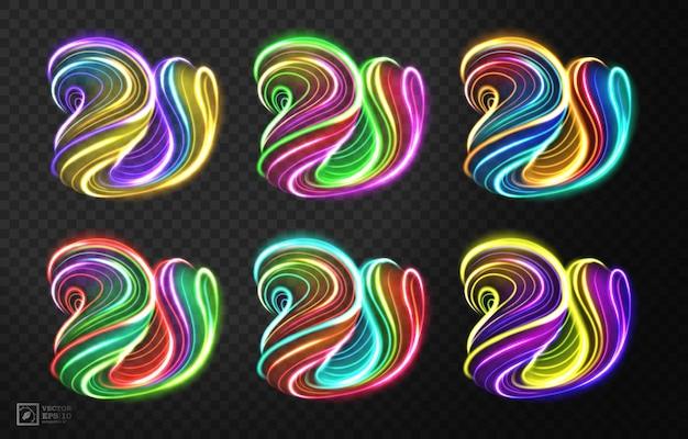 Linea di luce multicolore astratta di turbinio, isolata su fondo scuro.