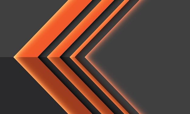 Direzione astratta dell'ombra leggera della freccia arancione geometrica sul fondo futuristico grigio di tecnologia
