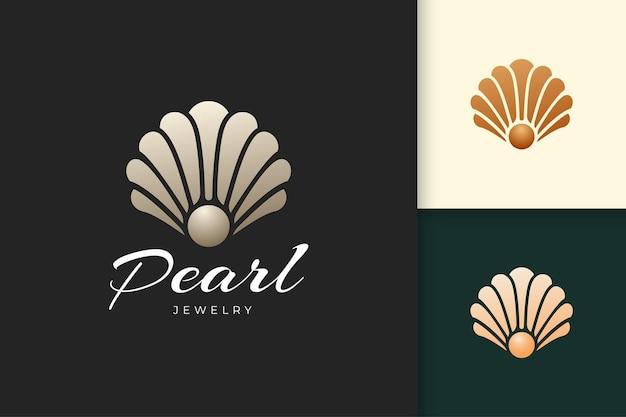 Logo astratto di perle o gioielli di lusso e a forma di conchiglia adatto per la bellezza e la cosmetica