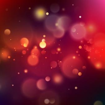 Bokeh rosa ed arancio astratto su fondo blu indaco.