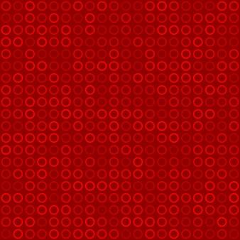 Modello senza cuciture astratto di piccoli anelli o pixel nei colori rossi