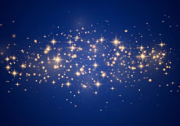 Effetto di luce elegante astratto su sfondo blu. polvere gialla scintille gialle e stelle dorate brillano di luce speciale. scintille di lusso particelle di polvere magica scintillante.