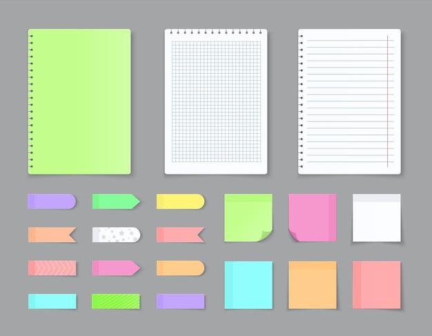 Adesivi adesivi e fogli colorati in bianco con quadrati e linee a griglia