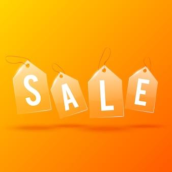 Concetto di design leggero pubblicitario con parola di vendita sui cartellini dei prezzi di vetro sull'arancio