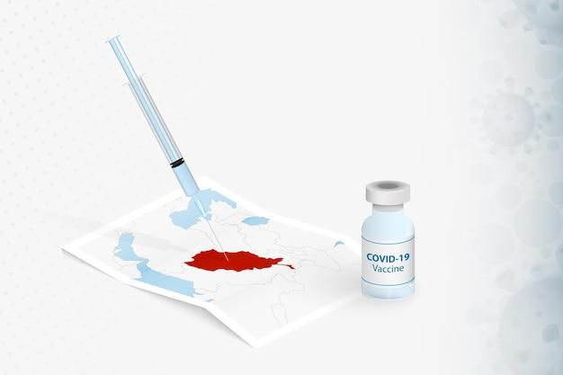 Vaccinazione in afghanistan, iniezione con vaccino covid-19 nella mappa dell'afghanistan.