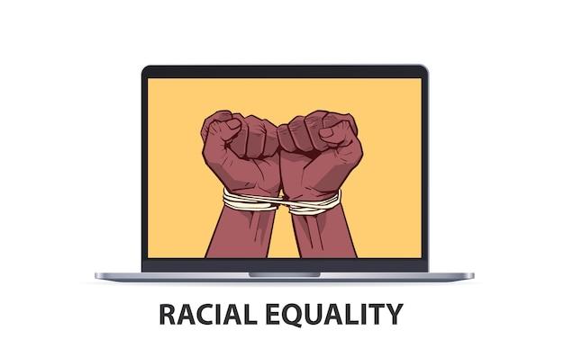 I pugni neri afroamericani legati con la corda sullo schermo del laptop fermano il razzismo l'uguaglianza razziale le vite nere contano