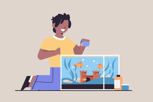 Ragazzo afroamericano che alimenta i pesci in acquario amicizia animale domestico con illustrazione vettoriale orizzontale a figura intera di concetto di animale domestico