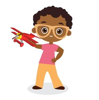 Ragazzo afroamericano con occhiali e aereo giocattolo. ragazzo che gioca con l'aeroplano. stile cartone animato piatto.