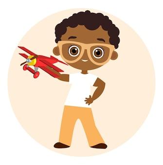Ragazzo afroamericano con occhiali e aereo giocattolo. ragazzo che gioca con l'aeroplano. illustrazione vettoriale eps 10 isolato su sfondo bianco. stile cartone animato piatto.