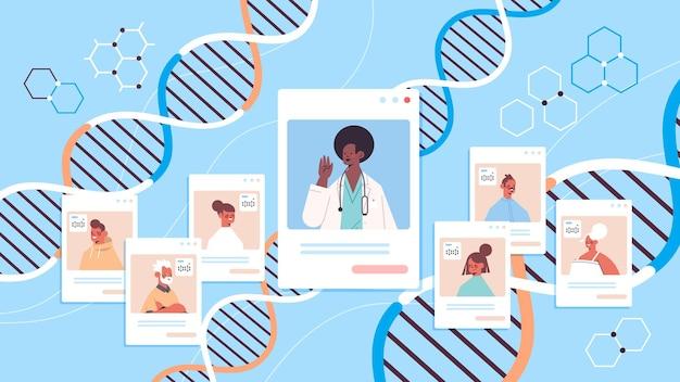 Medico afroamericano che consulta i pazienti nelle finestre del browser web test del dna diagnosi di ingegneria genetica