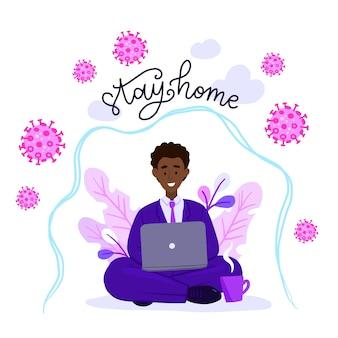 Uomo afroamericano nella posa del loto che lavora al suo computer portatile