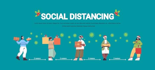 Afroamericani in maschere mantenendo la distanza sociale per prevenire la pandemia di coronavirus capodanno vacanze natalizie celebrazione concetto a figura intera orizzontale copia spazio illustrazione vettoriale