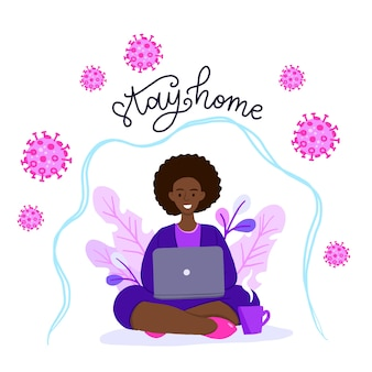 Donna afroamericana nella posa del loto che lavora al suo computer portatile