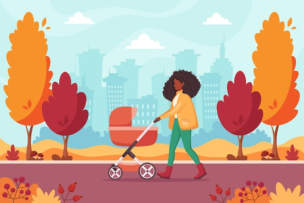 Donna afroamericana che cammina con la carrozzina nel parco autunnale