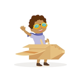 Il ragazzo africano usa gli occhiali e gioca con il giocattolo dell'aeroplano