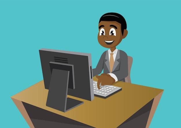 Uomo d'affari africano che lavora al computer