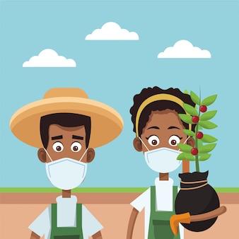 Coppie degli agricoltori di afro che indossano la scena medica delle maschere