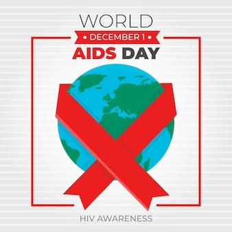 Aids day ribbon intorno al globo terrestre