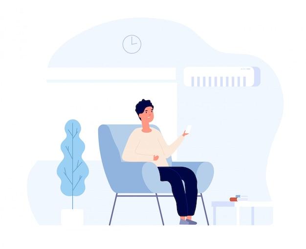 Concetto di condizionatore d'aria. giovane che si siede nella sedia domestica sotto il sistema di condizionamento d'aria. raffreddamento e pulizia della stanza estiva. immagine