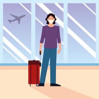 Aeroporto nuovo normale, uomo felice che indossa la maschera protettiva con la valigia