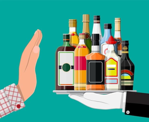 Concetto di abuso di alcol. la mano dà una bottiglia di alcol all'altra.