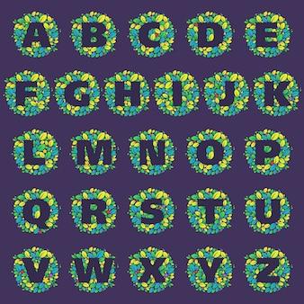 Loghi di lettere dell'alfabeto in un cerchio di foglie e fiori. stile del font