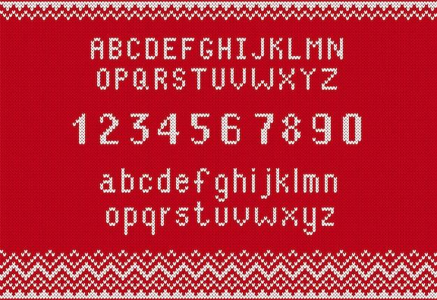 Alfabeto con numeri su trama rossa a maglia. carattere lavorato a maglia sulla stampa del maglione. modello senza cuciture