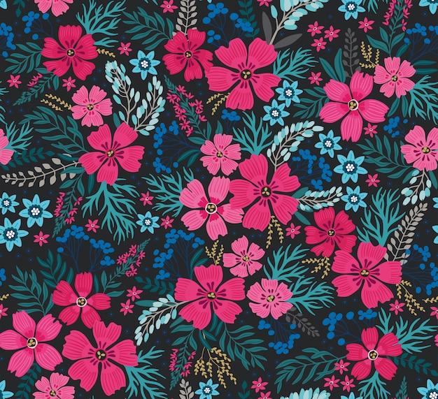 Fantastico motivo floreale senza soluzione di continuità con brillanti fiori colorati e foglie su uno sfondo blu scuro.