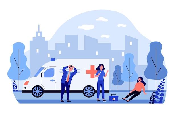 Brigata ambulanza che arriva per assistere la persona ferita