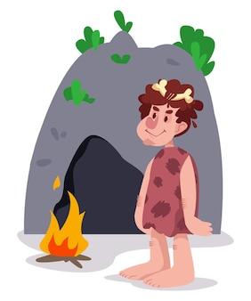 L'uomo antico pithecanthropus in pelle si trova accanto a una grotta e un falò