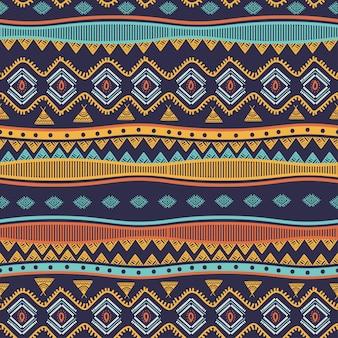 Il modello senza cuciture disegnato a mano tribale antico barra i simboli etnici