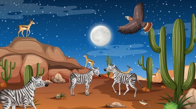 Gli animali vivono nel paesaggio della foresta desertica durante la scena notturna