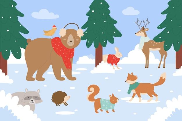 Animali nella foresta invernale che indossa sciarpa o maglione