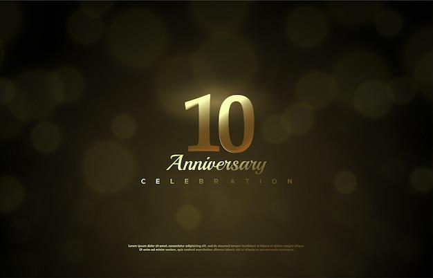 Celebrazione dell'anniversario con figure in oro e uno sfondo sfocato bokeh.