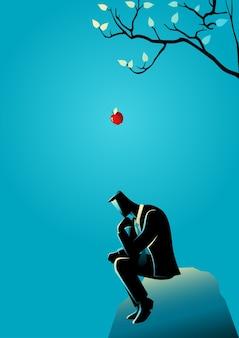 Apple che cade all'alba alla testa di un uomo d'affari pensante