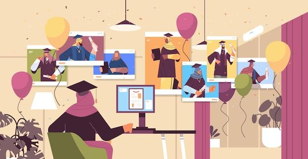 Studenti laureati arabi nelle finestre del browser web laureati arabi che celebrano il diploma accademico