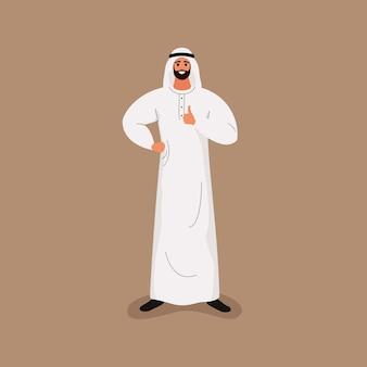 L'uomo barbuto bello arabo nei vestiti bianchi tradizionali mostra il pollice in su