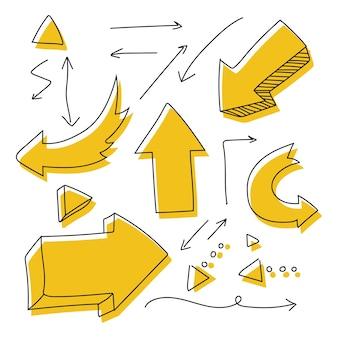 Insieme di vettore di doodle disegnato a mano freccia isolato su uno spazio bianco.