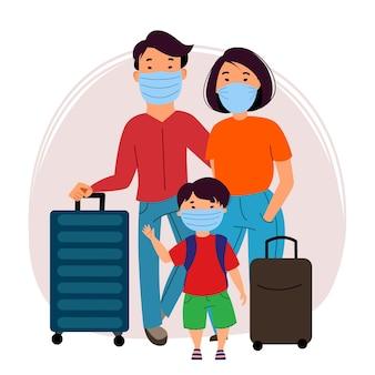 Una famiglia asiatica di turisti, un uomo, una donna e un bambino che indossano maschere e trasportano valigie