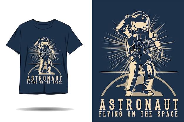 Astronauta che vola sul design della maglietta sagoma spaziale