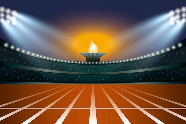 Stadio di atletica leggera con pista a vista frontale generale di notte.