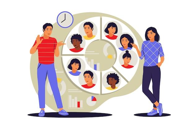Concetto di segmentazione del pubblico. persone vicino a un grande grafico circolare con immagini di persone. illustrazione vettoriale. appartamento.