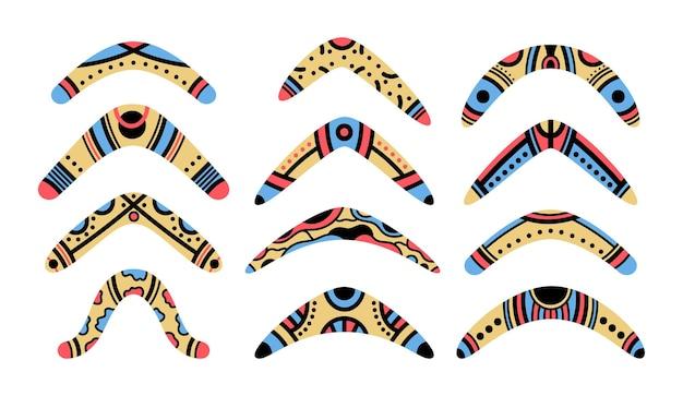 Insieme di simboli dell'illustrazione di vettore del fumetto dei boomerang di legno tradizionali di scarabocchio aborigeno australiano