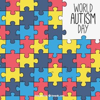 L'autismo sfondo giornata con pezzi di puzzle colorati