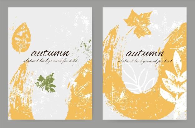 Fogliame astratto autunnale con una macchia di vernice e texture in stile grunge. disposizione verticale con motivi botanici.